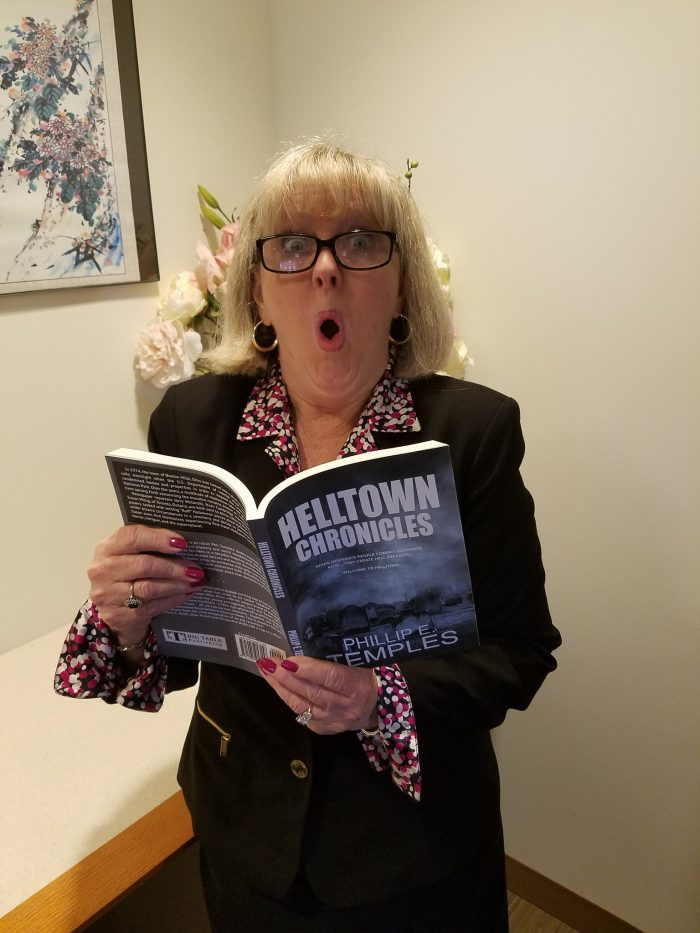 Leslie Douglas posed with copy of Helltown Chronicles